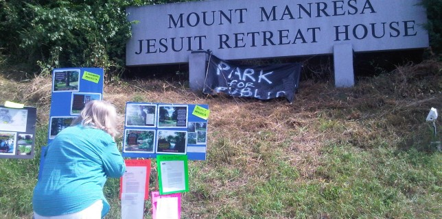 Rally goers look at Committee's argument to save Mount Manresa with Landmarking and Zoning.